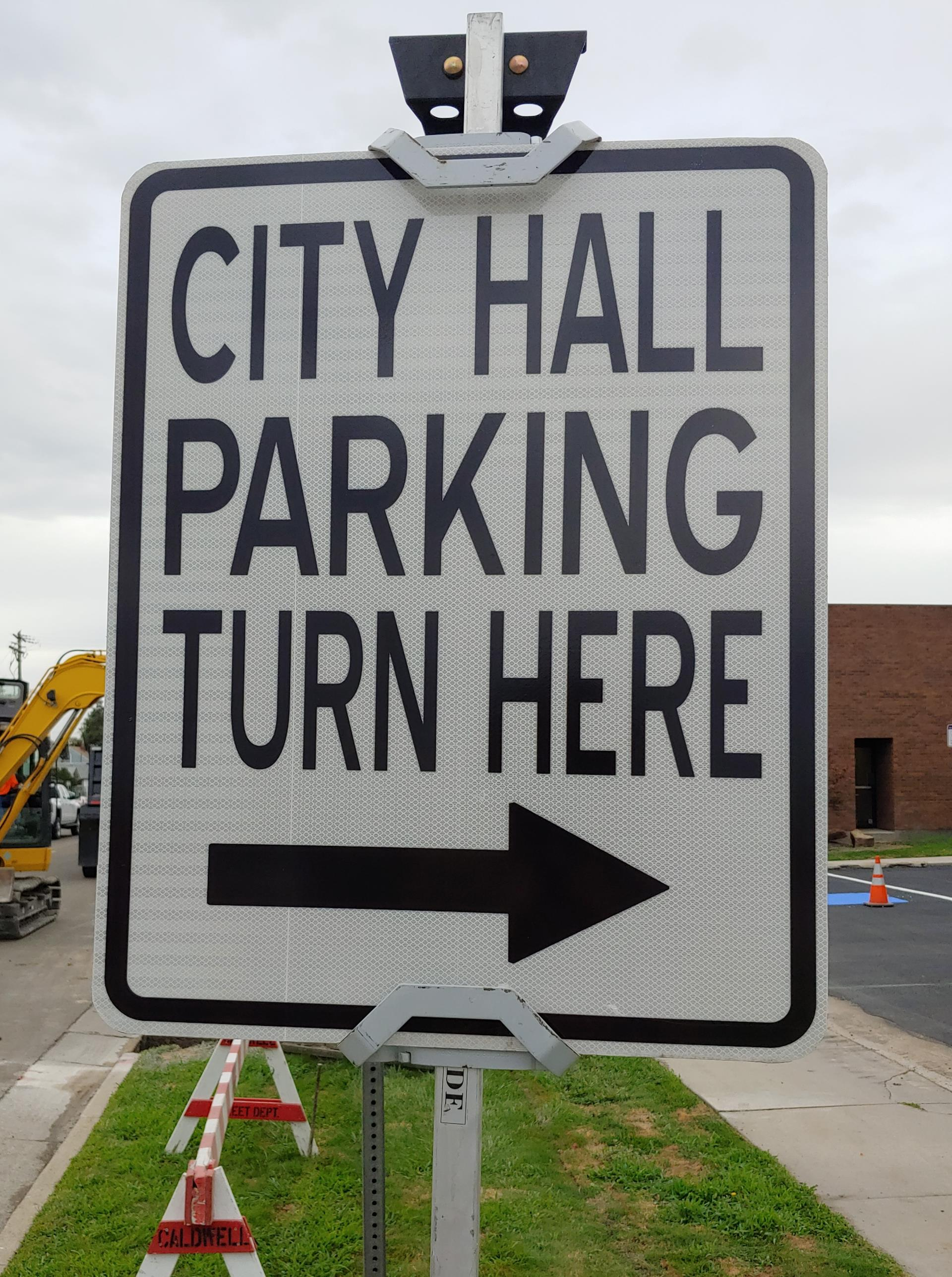 City Hall 'Park Here' sign fposted during construction